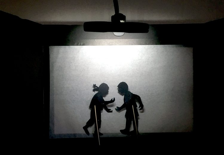 foam board portable screen showing boy and girl puppet