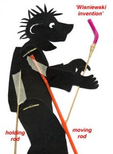 Image of a shadow puppet showing a holding rod (a barbecue skewer) and a moving rods made with bendable straws