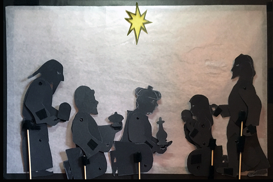 shadow puppet of three magi kneeling before Mary holding Jesus and Joseph