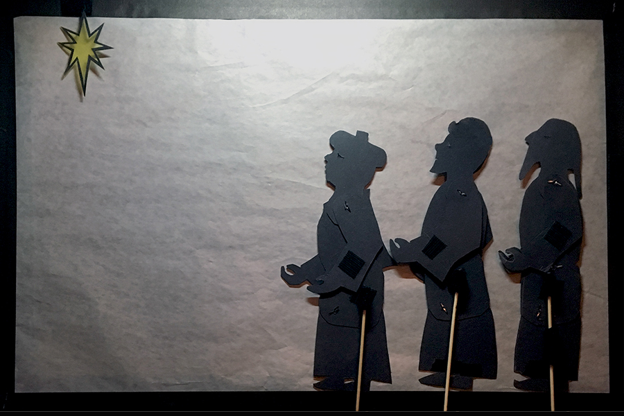 Shadow puppets of three wise men seeing the star