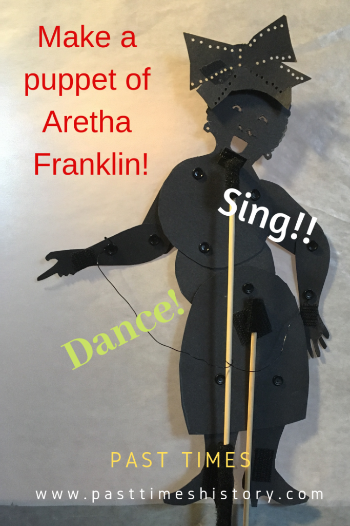 Front facing puppet of Aretha Franklin with hat she wore at Obama's inauguration