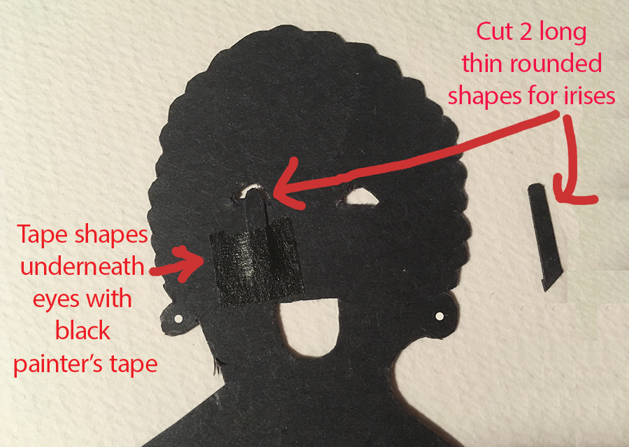 Front facing puppet head with instructions how to tape irises behind the eyes
