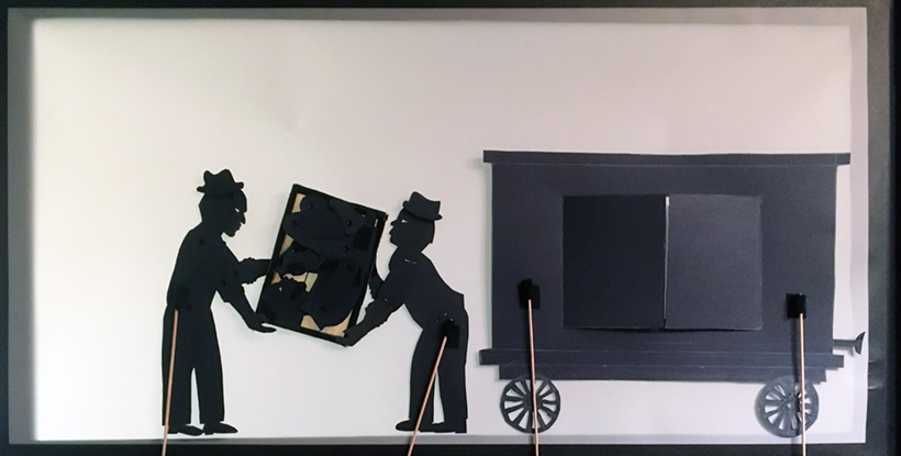 "Henry ""Box"" Brown shadow puppetry scene: box carried into the train"