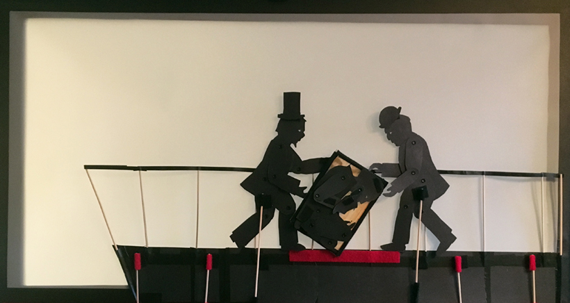 "Henry ""Box"" Brown shadow puppetry scene: box turned on its side by two passengers aboard the ship"