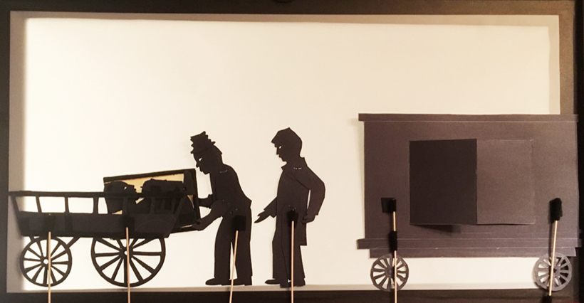 "Henry ""Box"" Brown shadow puppetry scene: box being moved from the train onto a wagon"
