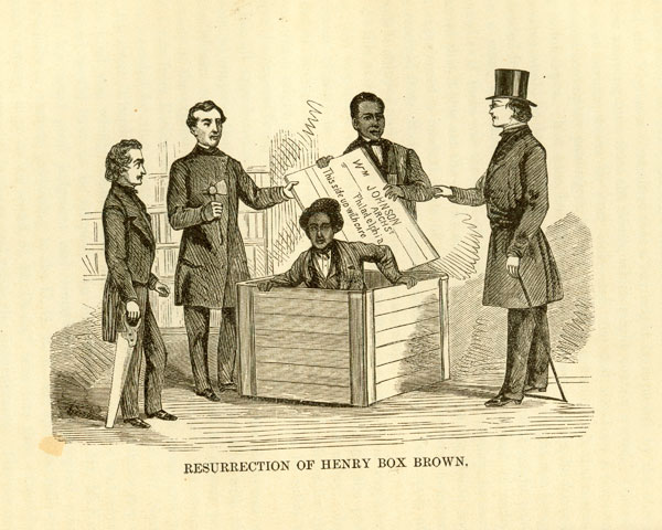 print Hendry Box Brown coming out of box with four men around him holding lid and tools
