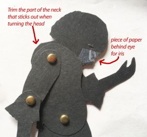 shadow puppet's upper body with brads connecting body parts