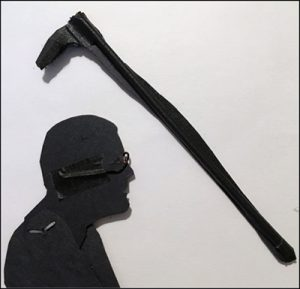 Reverse side of the puppet's head showing how glasses made of wire are taped to the back. The paper cane is supported by a piece of barbecue skewer.