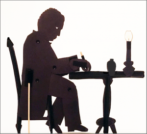 "Shadow puppet of William Still writing ""The Underground Railroad"""