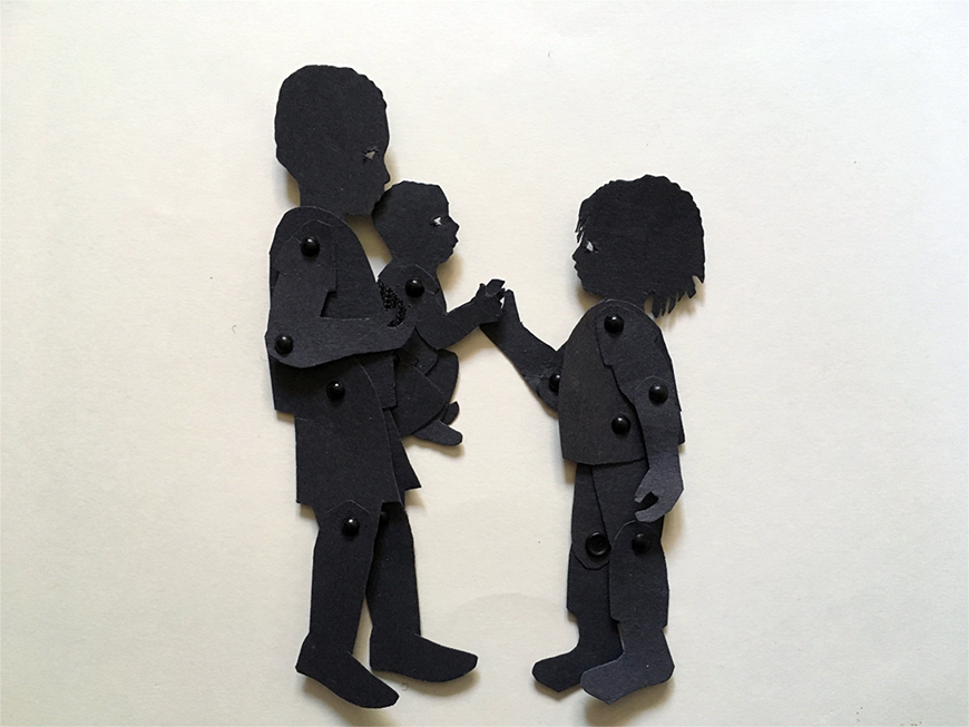 Shadow puppets of boy holding up a baby for his little sister