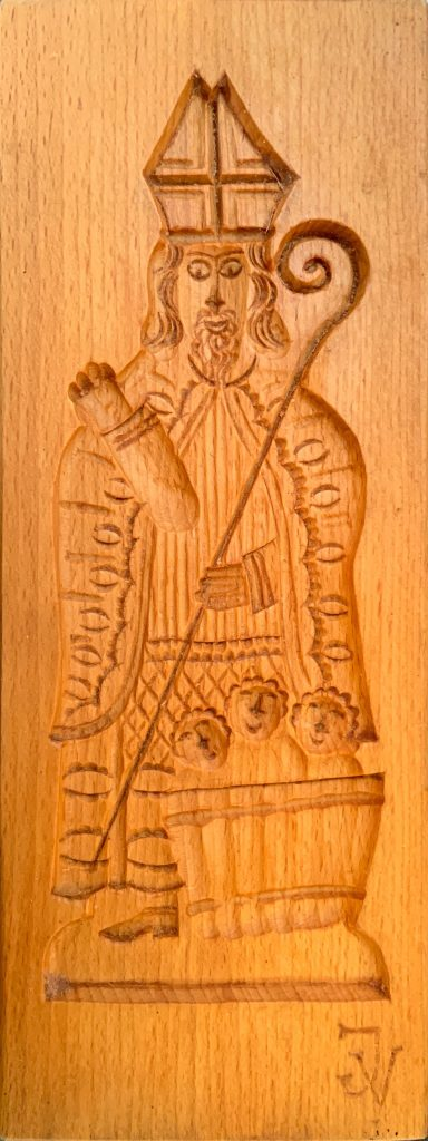 Wooden speculaas mold depicting saint