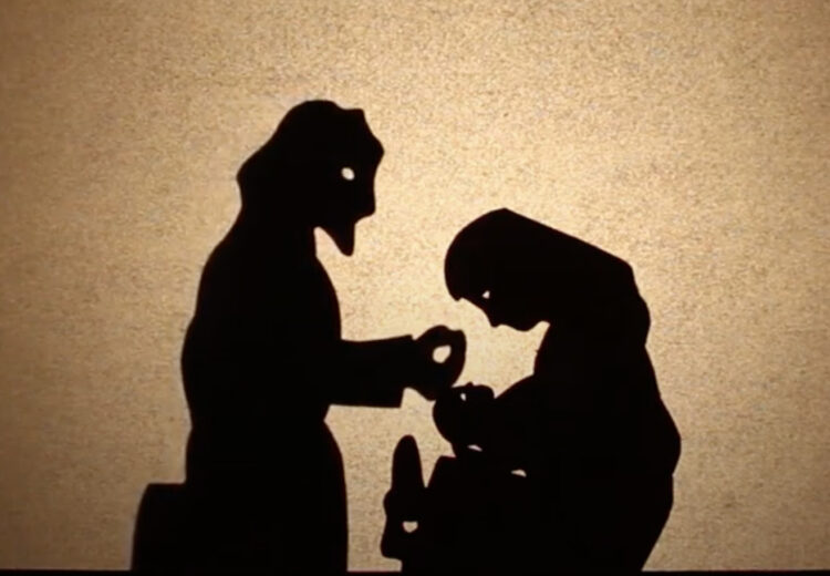Shadow puppets of Mary holding Jesus and Joseph caressing his head