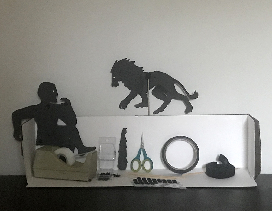 cardboard stand with Hercules and lion with supplies to make silhouette puppets