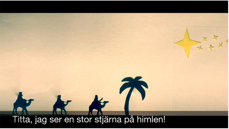 Profiles of three magi on camels with Swedish captioning
