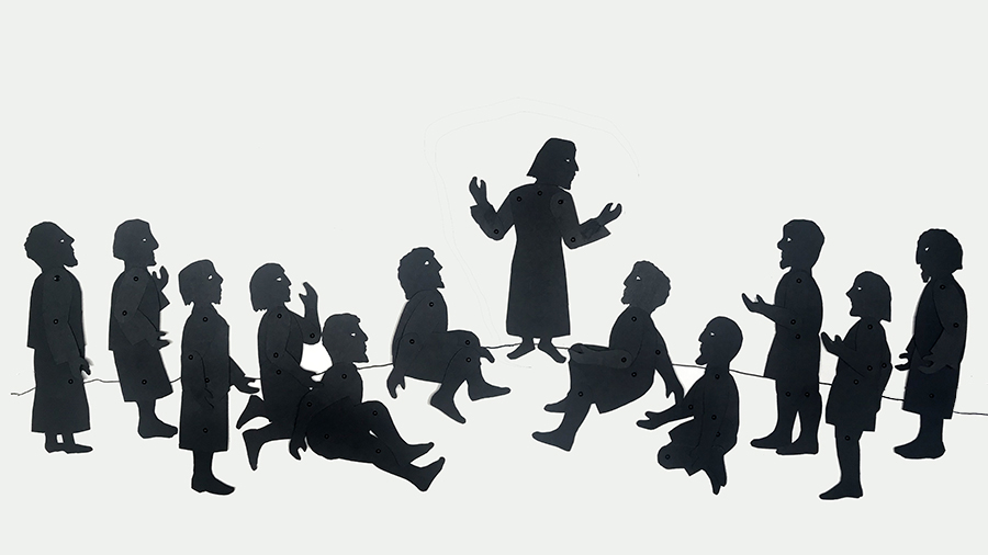 shadow puppets of Jesus talking to his disciples sitting or standing around him