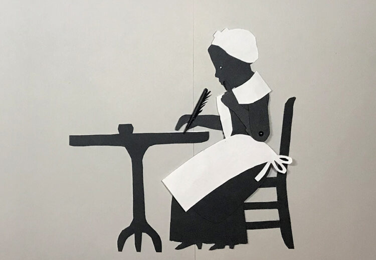 Silhouette puppet of Phillis Wheatley sitting at table writing